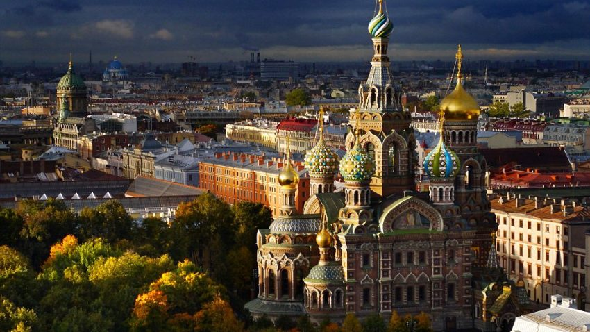 Mandatory Credit: Photo by Amos Chapple/REX (3242919a)  The Church on Spilled blood lit by morning sunlight on a squally day  Aerial views of Autumn in St Petersburg, Russia - Oct 2013  The Church was built on the site of the assassination of Tsar Alexander II in 1881.   Bathed in orange, gold and red, these breathtaking aerial images show St Petersburg in all its stunning Autumnal glory. The shots of the beautiful Russian city were taken using a small drone helicopter, with photographer Amos Chapple often having no idea how they would turn out.